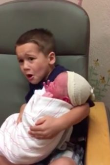 Brother Has Funny Reaction To Holding New Baby