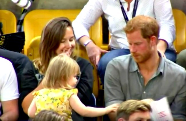 screenshot of video of Prince Harry's popcorn being stolen by a little girl at a game