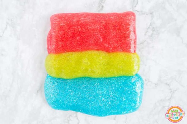 colored slime are arranged one above the other to make rainbow slime - how to make rainbow slime