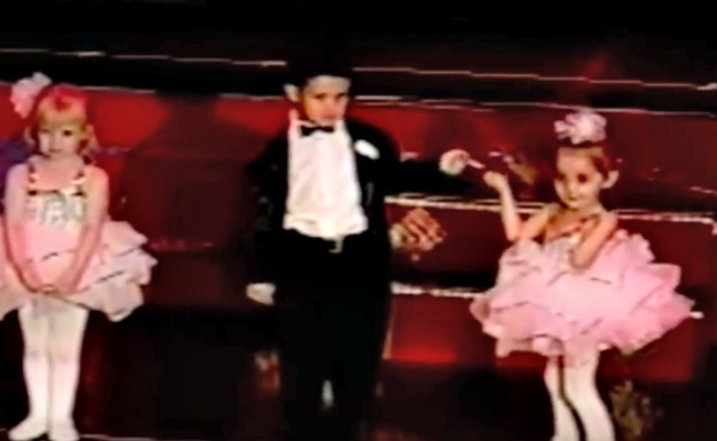screenshot from dance recital video with one partnership starting to dance