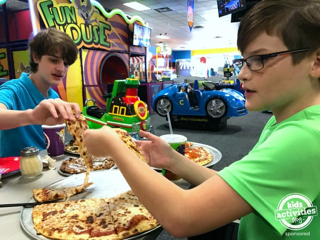 eating lunch at Chuck E Cheeses