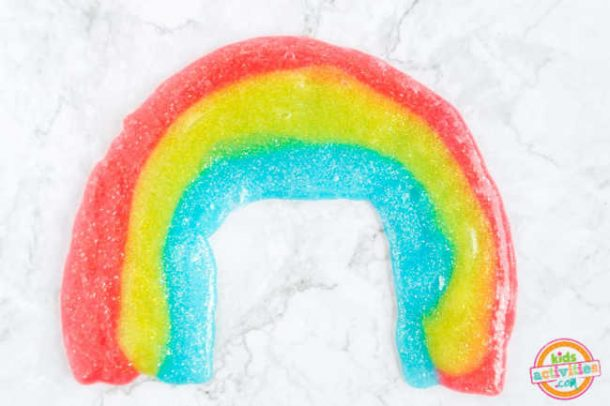 rainbow slime displayed in rainbow shape on a marble background