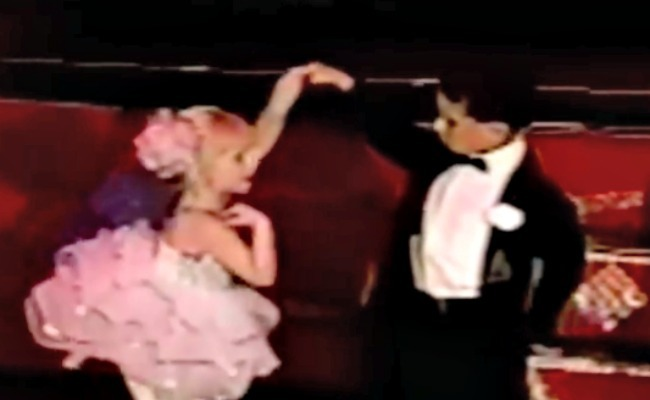 screenshot from little girl dance recital video - dancing together