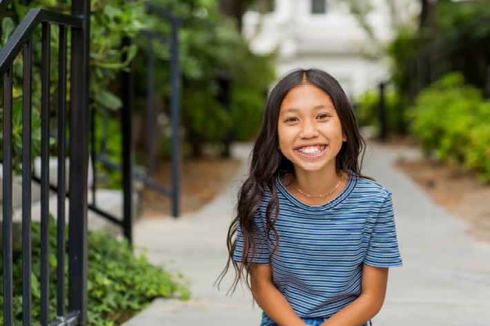 Defiant kids are strong kids that will change the world - Kids Activities Blog - girl smiling and looking at the camera