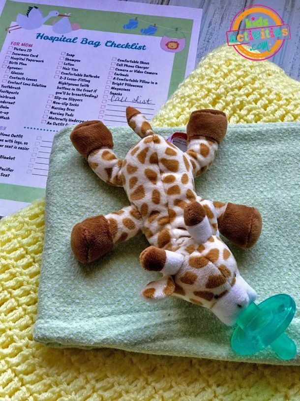 Hospital Bag When Having Baby Checklist And Stuffed Giraffe