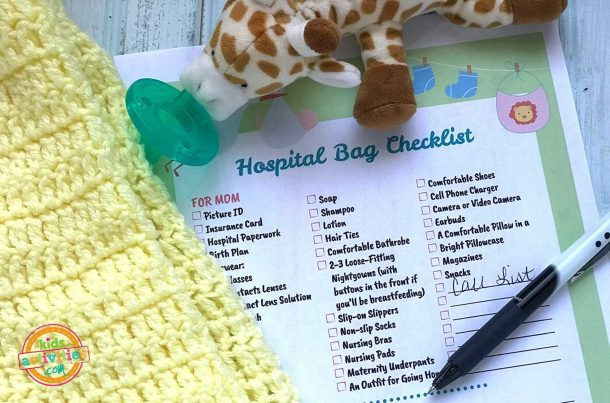 Hospital Bag When Having Baby Checklist And Toy Giraffe
