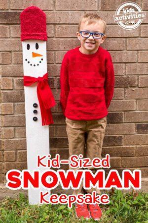 Kid Sized Snowman With Boy