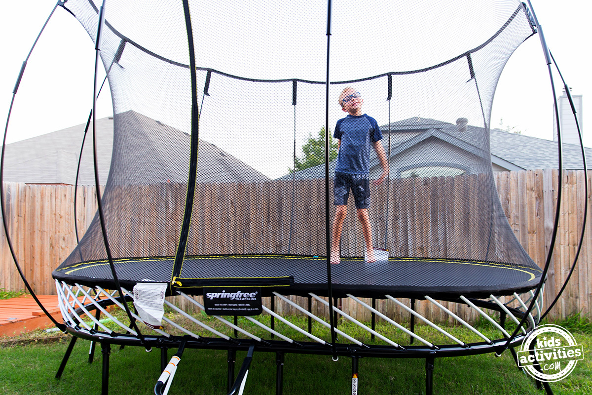 child jumping on springfree trampoline