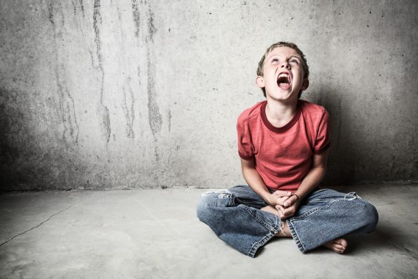 How to Raise a Defiant Child - boy sitting alone screaming