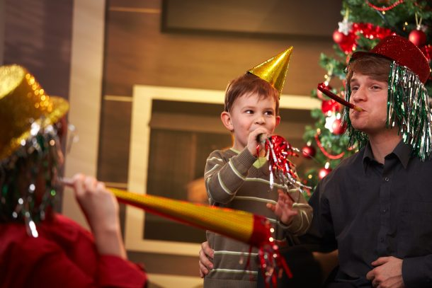 How to Plan a kids new years eve party with festive hats and noise makers