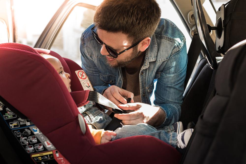 kid in rear facing car seat