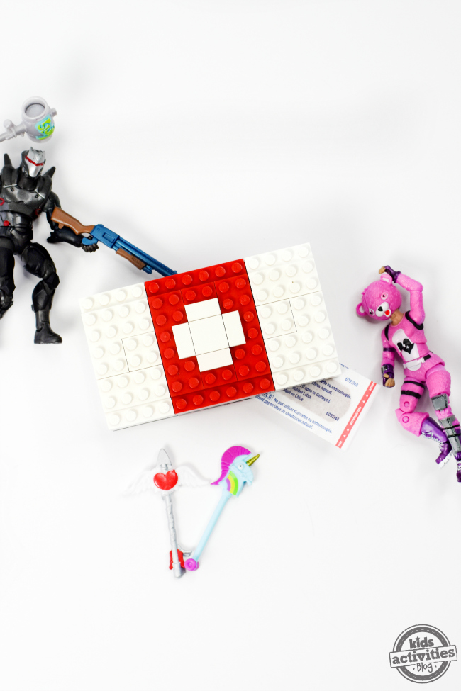 Built LEGO Fortnite MedKit with Fortnite action figures on either side