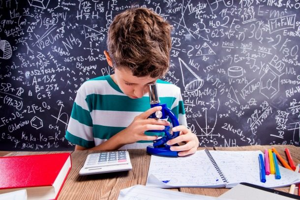 boy and microscope