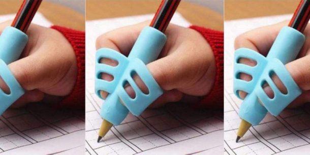 Prise de crayon avec de petits doigts écrivant à l'aide de l'outil d'écriture au crayon
