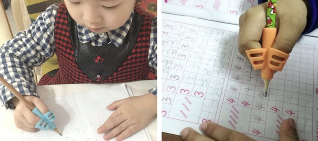 élèves utilisant l'outil d'écriture Pencil Grip en classe et la feuille de travail étant remplie avec un crayon Pencil Grip