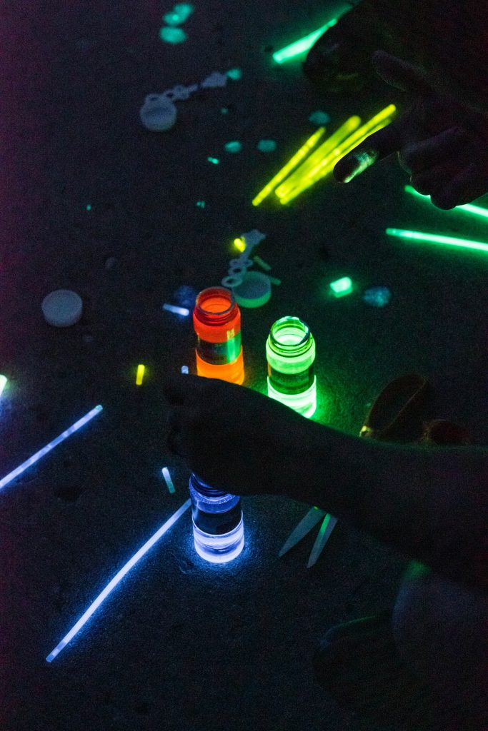 glow sticks being cut open and poured into bubbles