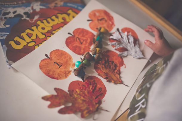 A stack of fall arts and crafts created by a preschooler.