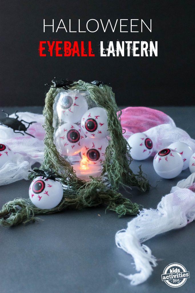 Fake eyeballs Halloween Lantern covered in plastic bugs, LED light inside, and white spider web and green netting