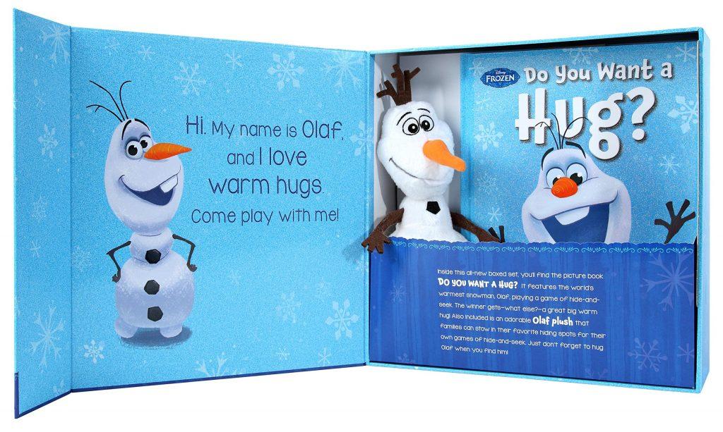 Le câlin et la peau de Frozen Olaf est livré avec un livre et un bonhomme de neige en peluche.
