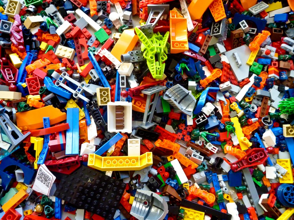 There are 75 millions LEGOS sold each year and many of them should be recycled to benefit people and the world.  Pictured are many variations of LEGOs in a pile.