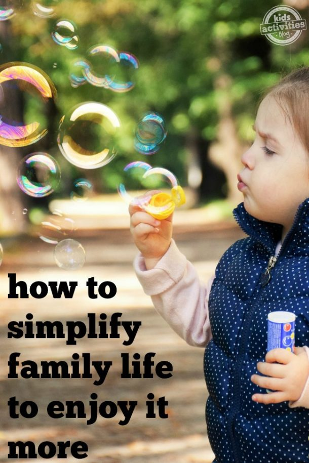 child blowing bubbles spending time with family