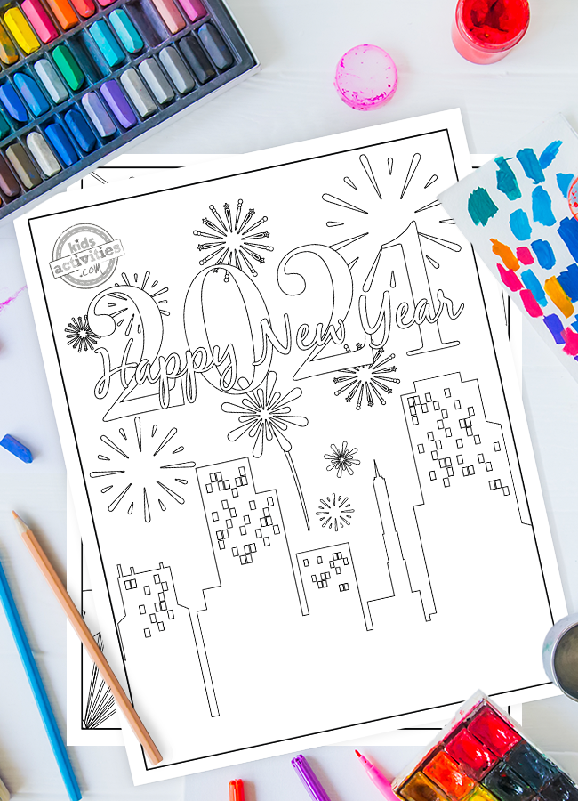 New Years coloring pages 2021 - shows skyline with fireworks surrounded by paint and crayons