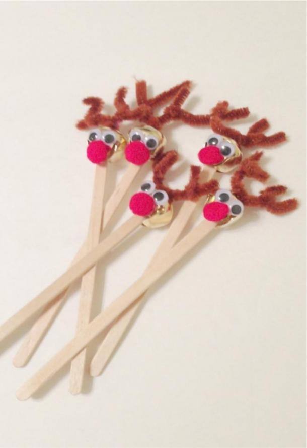 Reindeer Drink stirrers made from bells, red pom poms, and popsicle sticks.