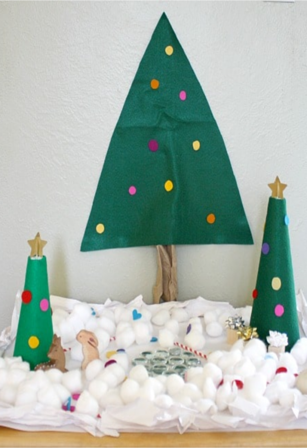 Snowy Christmas tree with fake water, snow, and presents