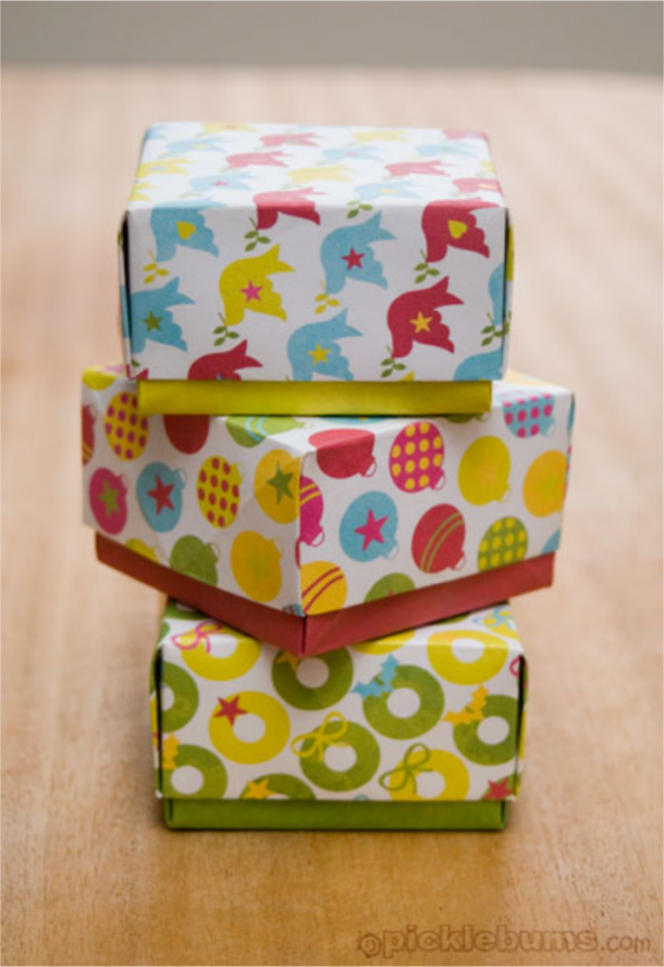 Christmas crafts like these free printable gift boxes with birds and starts, colorful ornaments, and yellow and green wreaths.