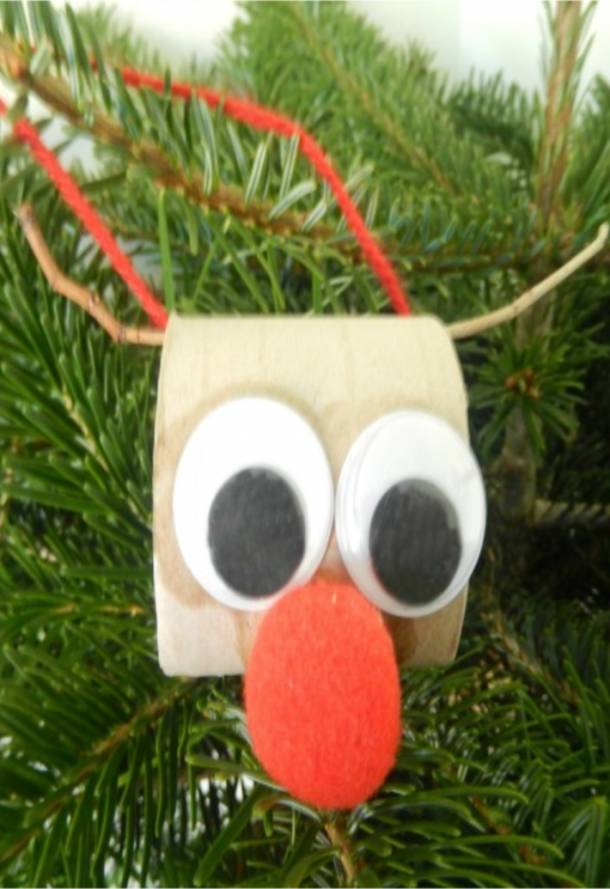 toilet roll Christmas reindeer with googly eyes, big pom pom nose, and stick antlers.