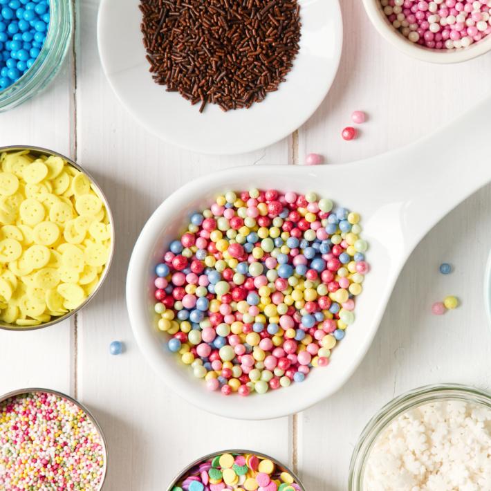 Bowls of sprinkles for Valentines pretzels - Kids Activities Blog