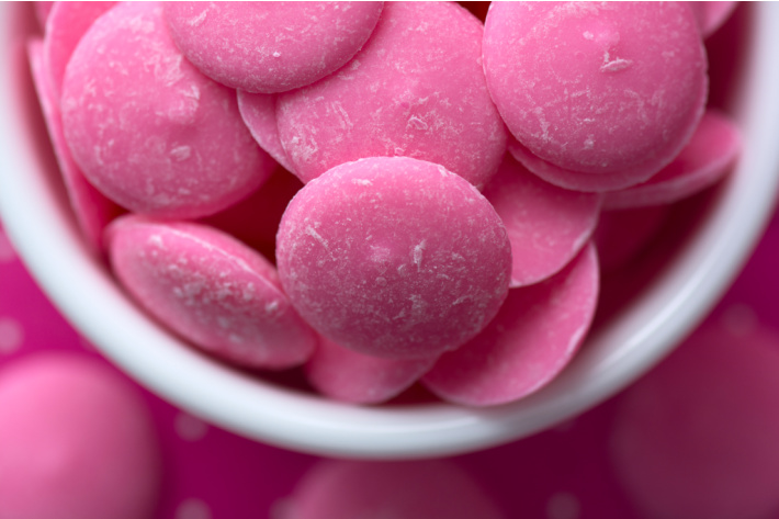 How to melt pink candy melts for Valentines Pretzels dipped and decorated - Kids Activities Blog - pink candy melts in a bowl