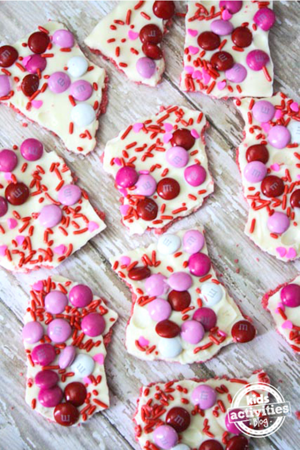 Valentine's day treat candy bark with m&ms, sprinkles, white chocolate, and strawberry wafers
