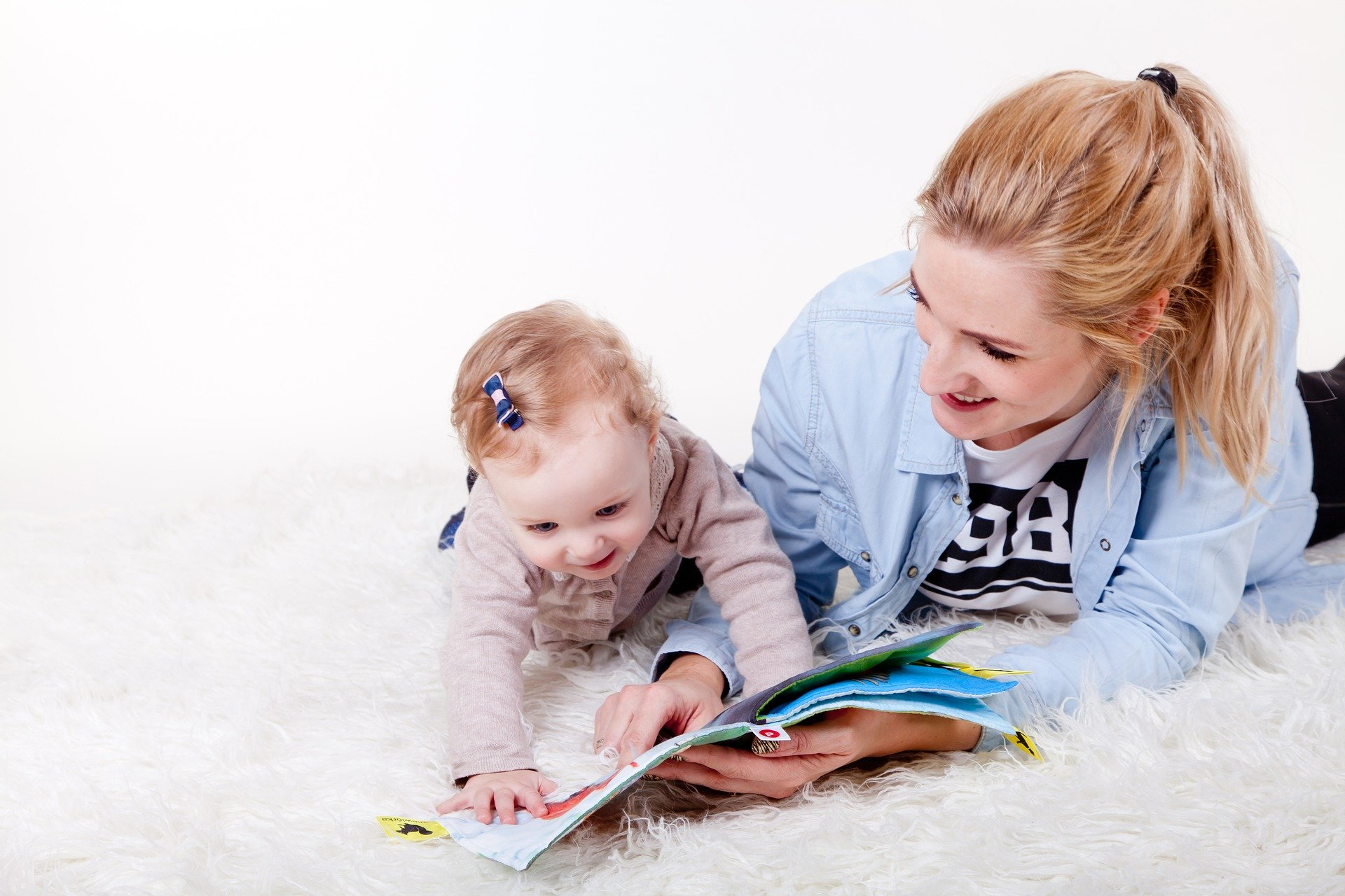 mom reading with baby - Dolly Parton's Imagination Library starts at birth