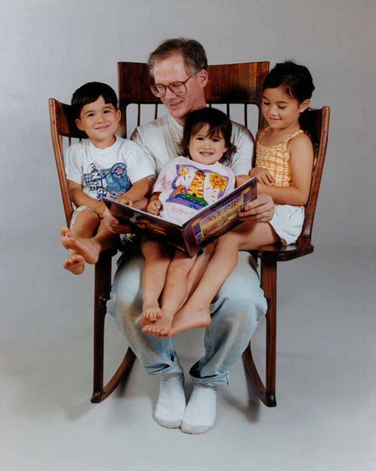 3 seat custom built rocking chair by Hal Taylor - father with three kids in rocker shown