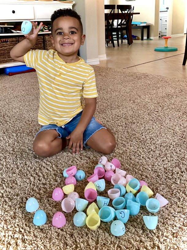 Plastic Easter egg matching game for preschoolers - boy with open plastic eggs