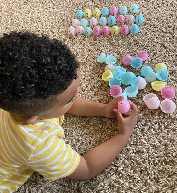 preschool letter matching eggs - preschooler separating out the upper case from lower case letters