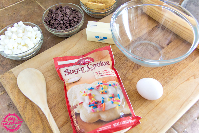 ingredients to make a giant sugar cookie pizza with marshmallows and chocolate chips
