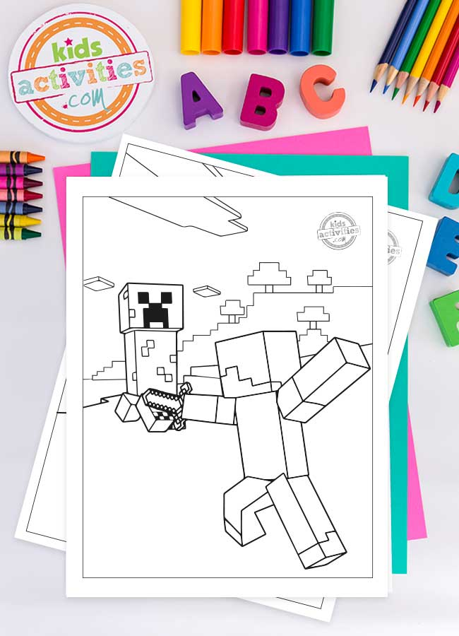 A Minecraft coloring sheet printed on white paper with Steve fighting a creeper with his diamond axe. Colorful art supplies and magnetic letters surround the printable.