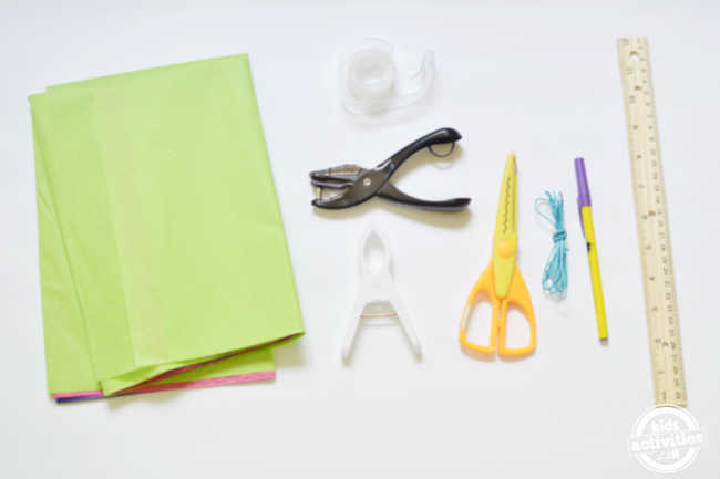 supplies for making papel picado day of the dead banner like tissue paper scissors hole punch