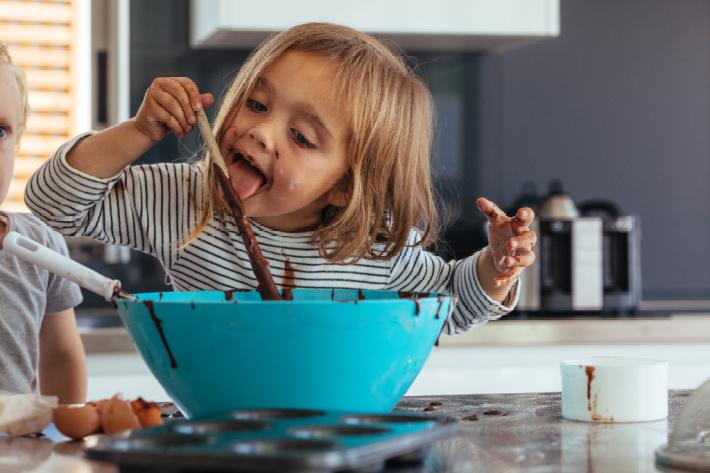 box cake mix tips to make them taste amazing from Kids Activities Blog - kid licking cake batter