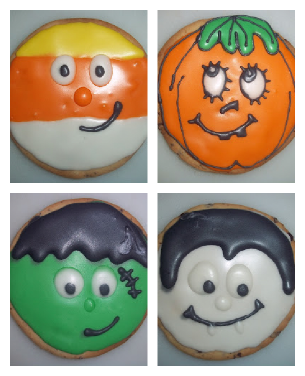 spooky sugar cookies with royal frosting that look like candy corn, pumpkin, Frankenstein, and dracula