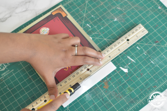 spellbook is made and the extras are trimmed using a ruler and craft knife