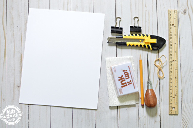supplies to make spell books displayed on wood background