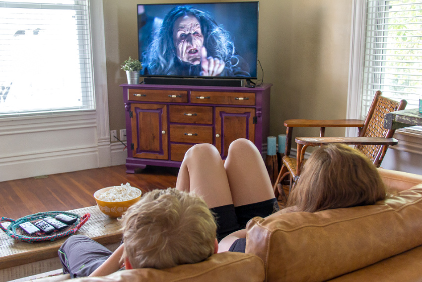 Kids watching Dwight in Shining Armor in their living room.
