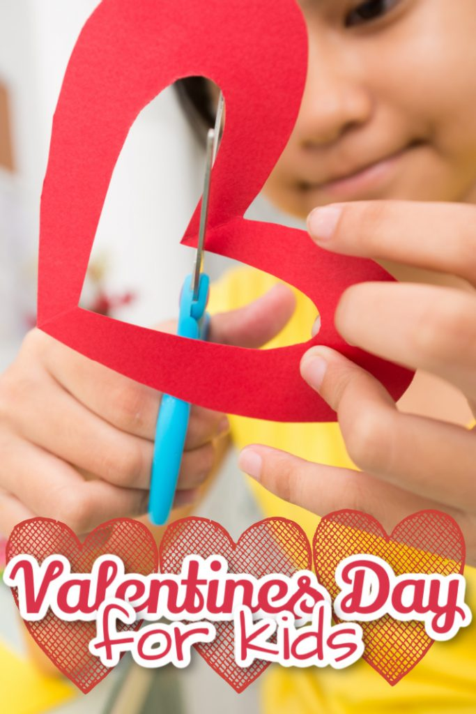 Valentines Day for Kids is full of Valentines crafts Valentines coloring pages and cards - Kids Activities Blog - girl cutting out paper heart