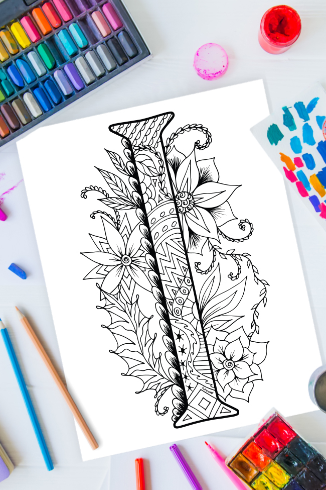 Zentangle alphabet coloring pages - letter I zentangle design on background of paint, colored pencils and art supplies