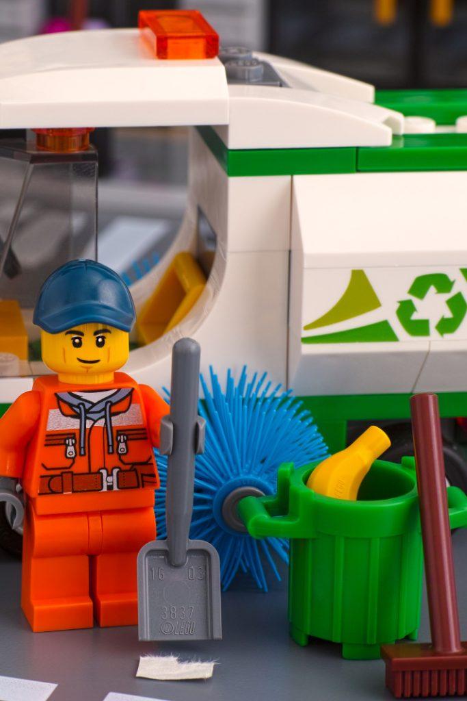 LEGO recycling program - what to do with used LEGOs bricks - Kids Activities Blog - LEGO minifigure recycling figuring with recycling truck and recycling bin