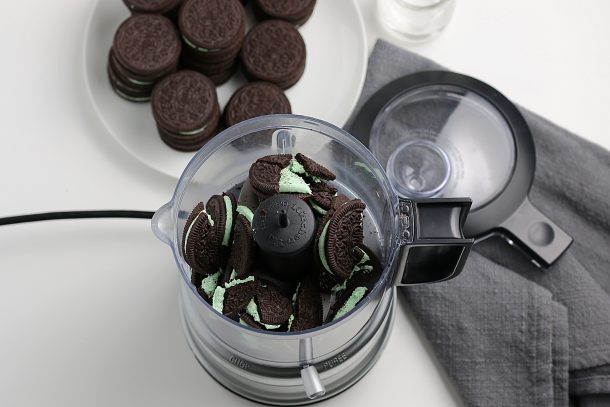 The Best Grasshopper Pie Recipe - Step crush mint and chocolate sandwich cookies to make your yummy crust!
