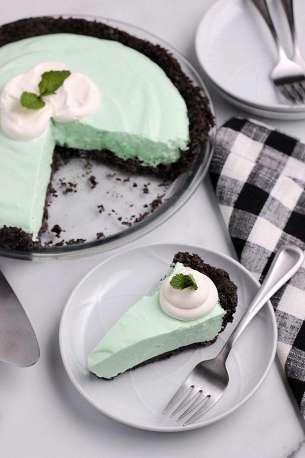 The Best Grasshopper Pie Recipe - A creamy mint and chocolate Grasshopper Pie with a slice cut out